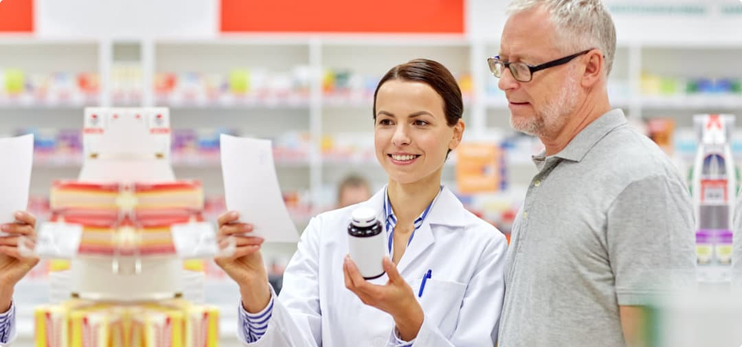 pharmacist and senior man buying medicines at the pharmacy