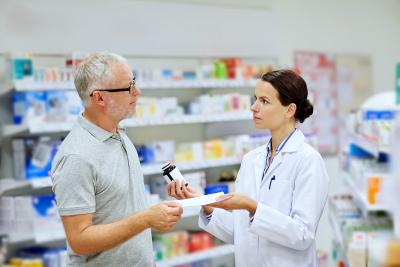pharmacist talking to the senior man